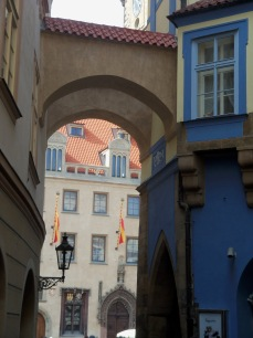 This is looking towards Old Town Square. The blue building will be on your left if you are in OT Square heading for Wenceslas Square.