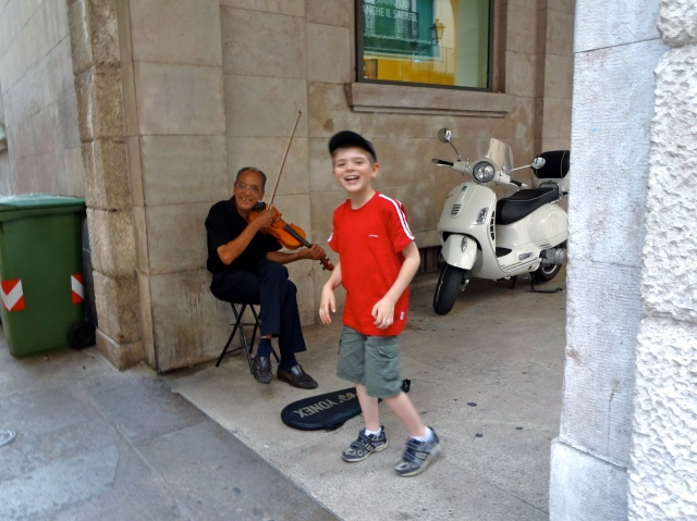 Nikolas delighted this street performer by insisting that we give him a coin!