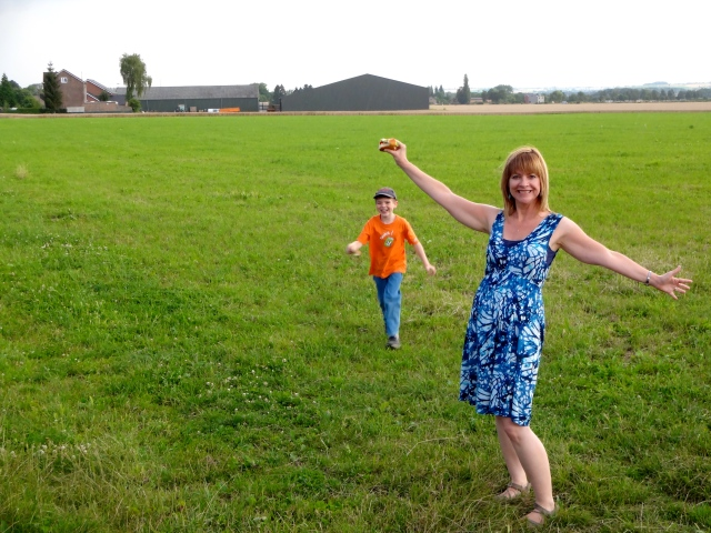 We got to frolic briefly in the field before a light rain chased us back into the car to finish our picnic:(