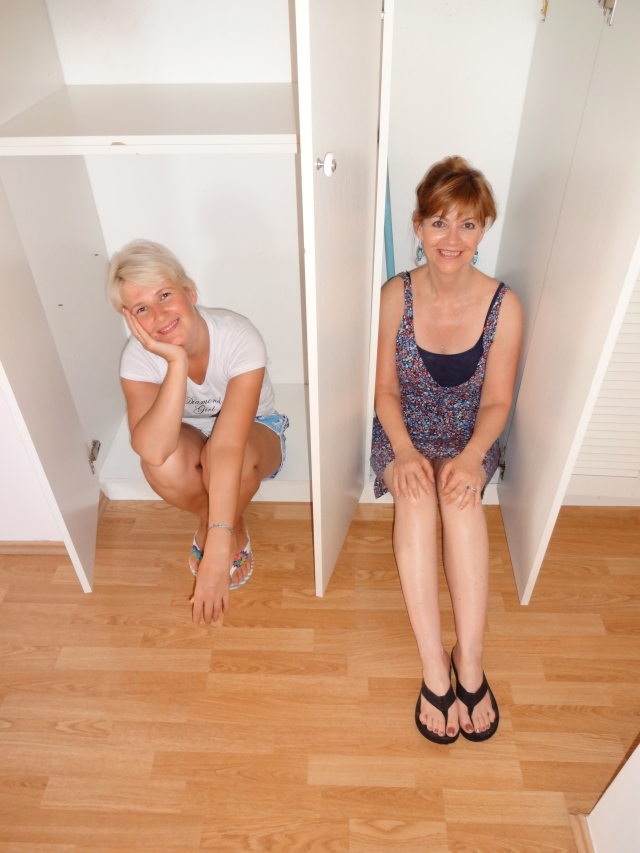 We were so tired after cleaning and packing all day!  The built in closet was the only place to sit down besides the floor.